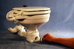 Hand pump toilet